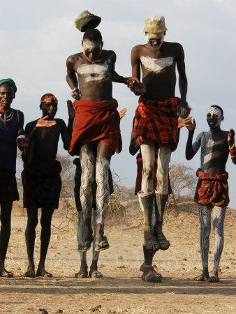 https://imgc.allpostersimages.com/img/posters/men-wearing-traditional-body-paint-in-nyangatom-village-dance-omo-river-valley-ethiopia_u-L-P584DW0.jpg?p=0