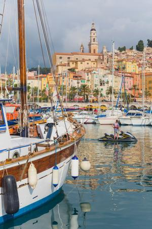 Menton, Cote d'Azur, French Riviera, France. View over harbour to the town.