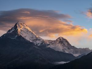 Asia, Nepal. Annapurna South (7,219 Meter) and clouds at sunrise, viewed from Poon Hill. by Merrill Images