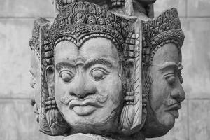 Cambodia, Siem Reap, carved statues at Buddhist temple. by Merrill Images