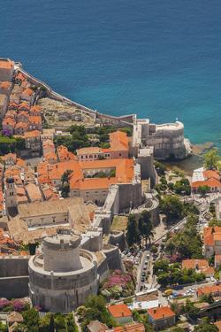 Croatia, Dubrovnik, a historic walled city and UNESCO World Heritage Site and the Adriatic Sea. by Merrill Images