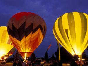 Hot Air Balloons During Night Glow, Kent, Washington, USA by Merrill Images