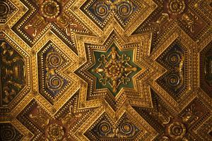 Italy, Rome, Trastevere, ornate gold ceiling in cathedral. by Merrill Images