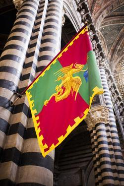 Italy, Siena, flag in Duomo cathedral. by Merrill Images