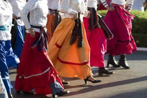 Mexico, Yucatan, Merida, Dancers with Swirling Skirts in Parade by Merrill Images