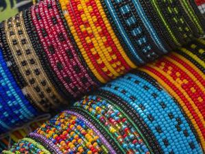 Panama, San Blas Islands, beaded bracelets for sale. by Merrill Images