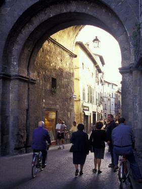 Pedestrians Entering Archway, Lucca, Italy by Merrill Images