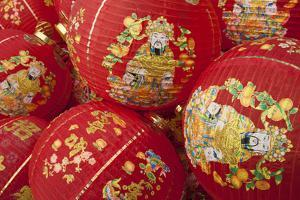 Thailand, Bangkok, Paper lanterns in a pile before being hung for festival. by Merrill Images