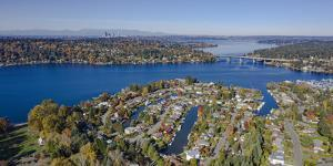 USA, Washington State, Bellevue. Lake Washington and SR520 floating bridge in autumn by Merrill Images