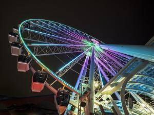 USA, Washington State, Seattle, ferris wheel at night. by Merrill Images