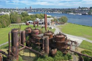 USA, Washington State, Seattle, rusted gas tanks at Gas Works Park and Lake Union. by Merrill Images