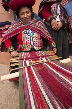 Woman Weaving at Backstrap Loom, Weaving Cooperative, Chinchero, Peru by Merrill Images