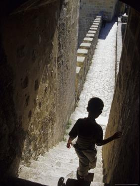 Young Boy in Tower of Castelo de Sao Jorge, Portgual by Merrill Images