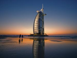 Burj Al Arab Hotel Reflected on Beach at Sunset by Merten Snijders