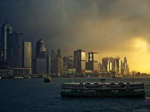 Ferry and Hong Kong Island Waterfront with Skyscrapers by Merten Snijders
