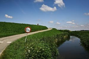 Narrow Road by Canal. by Merten Snijders
