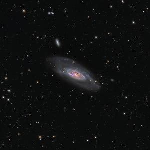 Messier 106, a Spiral Galaxy in the Constellation Canes Venatici