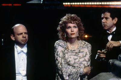 https://imgc.allpostersimages.com/img/posters/mia-farrow-and-tony-roberts-radio-days-1987-directed-by-woody-allen-photo_u-L-Q1C3LY50.jpg?artPerspective=n