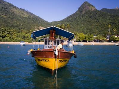 Man on Moored Boat Off Ilha Grande Shore