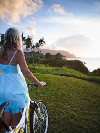 Woman Bike Riding, Makai Golf Course, Kauai, Hawaii, USA