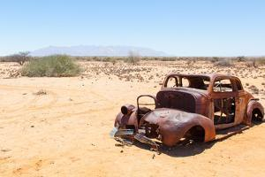 Abandoned Car in the Namib Desert by Micha Klootwijk