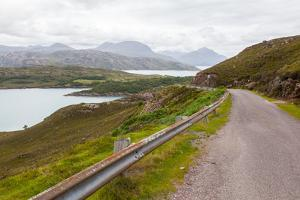 Highlands of Scotland Narrow Road in Mountain Landscape by Micha Klootwijk