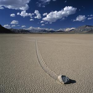 Rock Pushed by Wind in Desert by Micha Pawlitzki