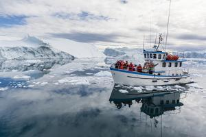 A Commercial Iceberg Tour Amongst Huge Icebergs Calved from the Ilulissat Glacier by Michael