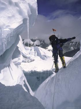 Climber Scaling the Khumbu Ice Fall, Nepal by Michael Brown