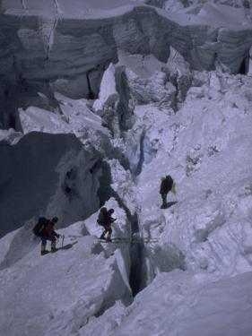 Climbers Crossing Ladder on Everest, Nepal by Michael Brown
