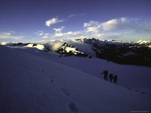 Climbers Follow Footsteps in the Snow, New Zealand by Michael Brown