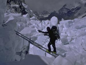 Climbing Across Ladder on Everest, Nepal by Michael Brown