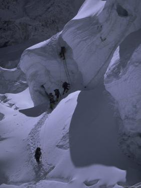Climbing Khumbu Ice Fall, Nepal by Michael Brown
