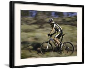 Mountain Biker Against a Blurry Background, Mt. Bike by Michael Brown
