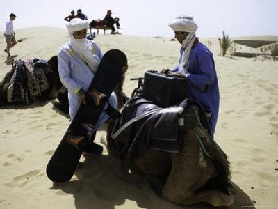 Packing up a Camel, Morocco by Michael Brown