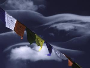 Prayer Flags Infront of Clouds, Nepal by Michael Brown