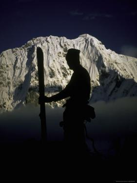 Skier's Silhouette, Tibet by Michael Brown