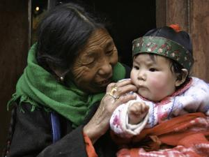 Woman with Child, Tibet by Michael Brown