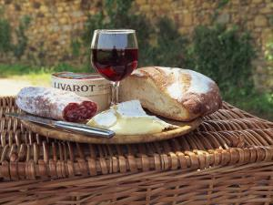 Still Life of Picnic Lunch on Top of a Wicker Basket, in the Dordogne, France by Michael Busselle