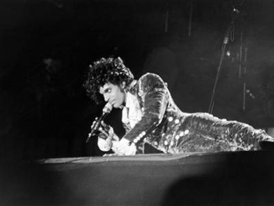 Prince, Lying on Stage During His Purple Rain Tour, 1984