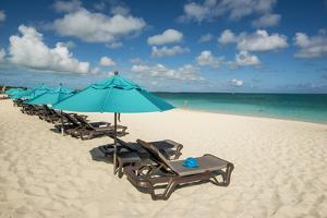 Beach umbrellas on Grace Bay Beach, Providenciales, Turks and Caicos Islands, Caribbean. by Michael DeFreitas