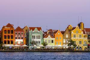 Colorful buildings, architecture in capital city Willemstad, Curacao. by Michael DeFreitas