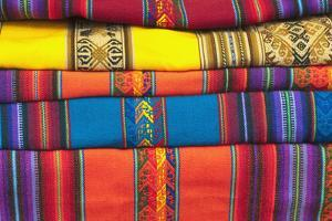 Knitted blankets at arts and craft market, Urubamba, Peru by Michael DeFreitas