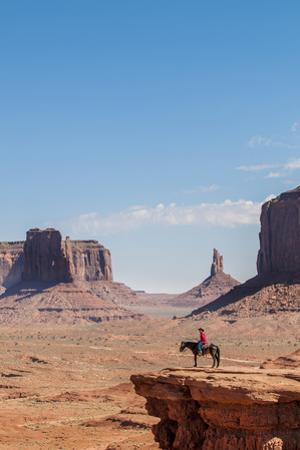 Navajo Man on Horseback, Monument Valley Navajo Tribal Park, Monument Valley, Utah by Michael DeFreitas