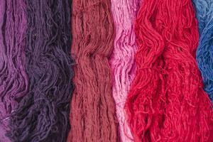 Peru, Chinchero. Dyed wool Chinchero, Peru. by Michael DeFreitas