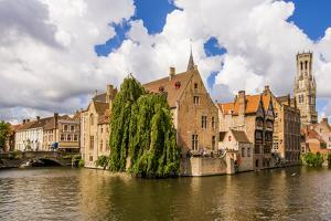 Rozenhoedkaai canal with Belfort tower, Bruges, West Flanders, Belgium. by Michael DeFreitas