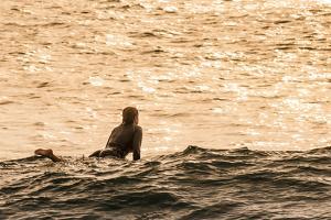 Surfing in Turtle Bay, North Shore, Oahu, Hawaii by Michael DeFreitas