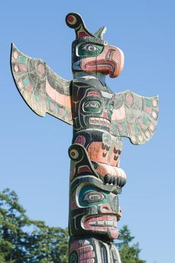 Totem Poles in Cemetery in Alert Bay, British Columbia, Canada, North America by Michael DeFreitas