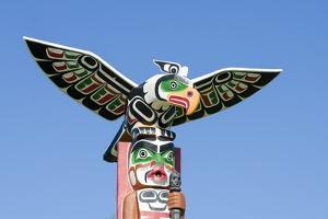 Totem Poles in Cemetery in Alert Bay, British Columbia, Canada, North America by Michael DeFreitas
