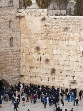 Worshippers at the Western Wall, Jerusalem, Israel, Middle East by Michael DeFreitas